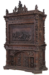 AN ITALIAN CARVED WALNUT SECRE