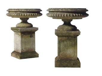 A PAIR OF COMPOSITION URNS AND