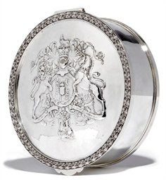 A SILVER BOX IN THE FORM OF A