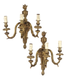 A SET OF FOUR GILT-BRASS WALL