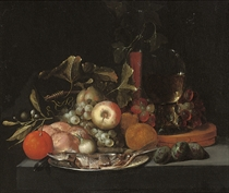 A herring on a pewter platter with oranges, figs, apples, grapes, a loaf of bread, a façon de Venise glass and a Roemer on a stone ledge