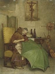 A monk repairing an umbrella