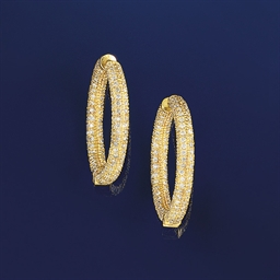 A pair of diamond set earrings