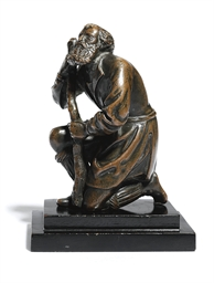 A BRONZE FIGURE OF A KNEELING