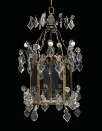 A LOUIS XV BRASS AND CRYSTAL L