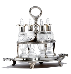 A GEORGE III FOUR-BOTTLE SILVE