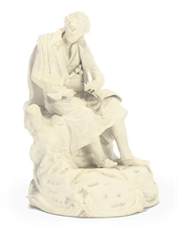 A WHITE PORCELAIN FIGURE OF A