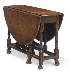 AN OAK GATELEG TABLE