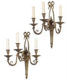 A PAIR OF GILT-BRASS THREE-LIG