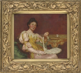 An elegant lady seated in an i