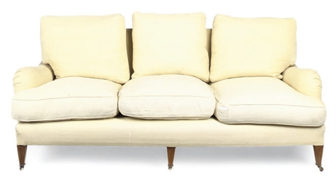 A YELLOW LINEN UPHOLSTERED SOF