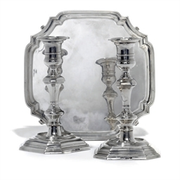 A PAIR OF SILVER CAST CANDLEST
