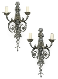 A PAIR OF SILVERED BRONZE TWIN