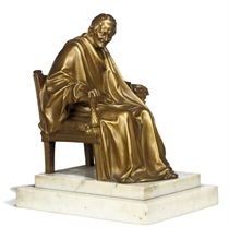 A FRENCH GILT-BRONZE STATUETTE OF VOLTAIRE SEATED