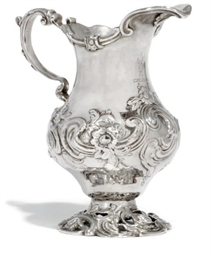 AN EARLY GEORGE III ROCOCO SILVER CREAM JUG