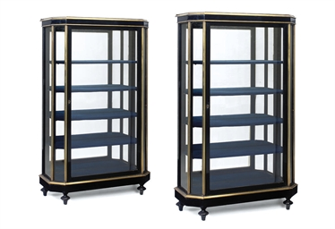 A PAIR OF EBONISED AND BRASS M