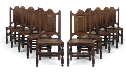 A SET OF TEN SOLID SEAT CHAIRS