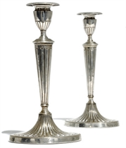 A PAIR OF LATE VICTORIAN SILVER CANDLESTICKS