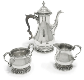 A GEORGE III SILVER COFFEE POT