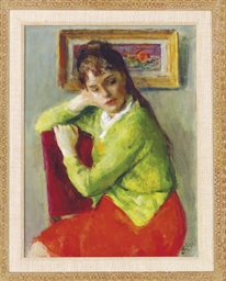 A seated girl in a red dress a