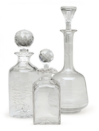 A GROUP OF SEVEN GLASS DECANTE