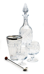 A GROUP OF GLASS DECANTERS AND