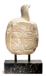 AN EGYPTIAN-STYLE STONE SCULPT