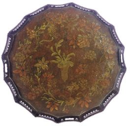 A POLYCHROME-PAINTED METAL TRA