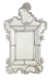 A VENETIAN GLASS MIRROR,