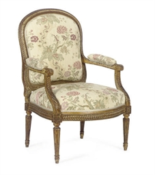 A GILTWOOD AND UPHOLSTERED FAU