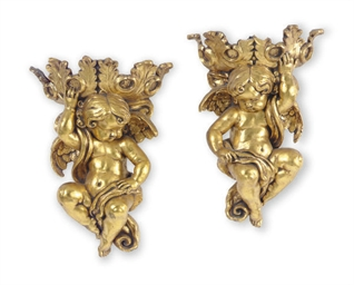 A PAIR OF GILT-COMPOSITION FIG