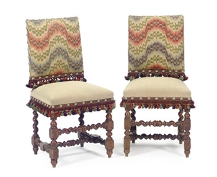 A PAIR OF OAK AND UPHOLSTERED