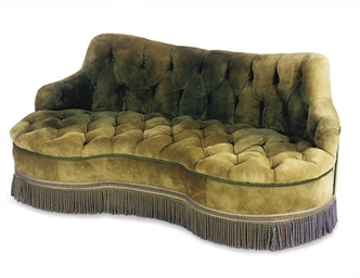 A GREEN SUEDE UPHOLSTERD BUTTO