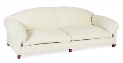A WHITE WOVEN WOOL UPHOLSTERED