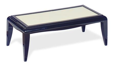 AN EBONIZED AND GLASS LOW TABL