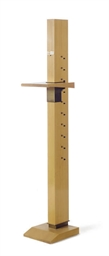 AN ADJUSTABLE BIRCH EASEL,