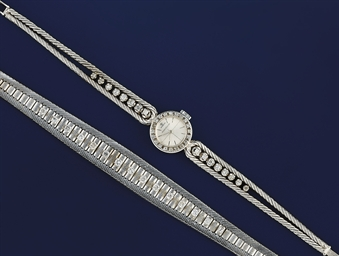 A DIAMOND WRISTWATCH AND BRACE