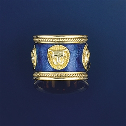 An 18ct. gold and enamel astro
