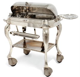 A SILVER-PLATED CARVING TROLLE