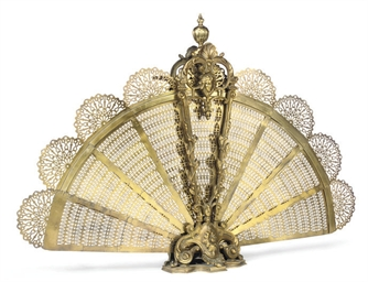 A BRASS FAN SHAPED FIRE-GUARD
