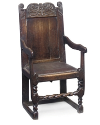 A SOUTH YORKSHIRE OAK ARMCHAIR