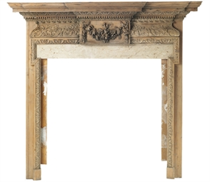 A LATE GEORGE III CARVED PINE