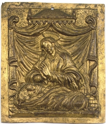 A GILT-COPPER RELIEF PLAQUE OF