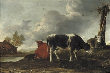Cattle on a riverbank with a c