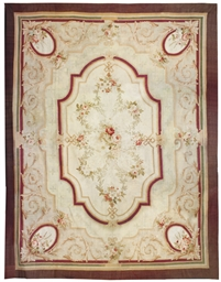 A LARGE AUBUSSON CARPET