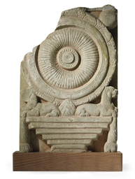 A carved marble plaque with th