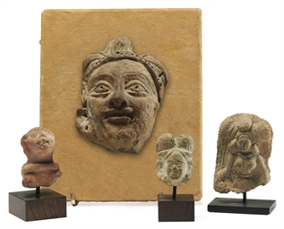 Four terracotta heads