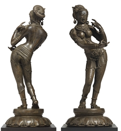 A bronze figure of a dancing g