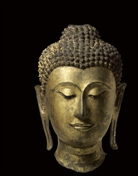 A gilt bronze head of Buddha