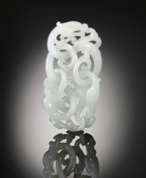 A FINELY CARVED WHITE JADE DRA